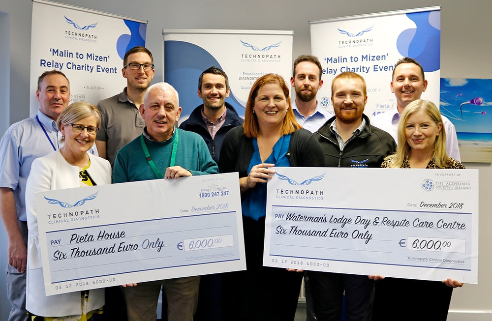 Presentation from Technopath to Pieta House and Alzheimers Society of Ireland of funds raised from 'Malin to Mizen' Charity Relay Run.